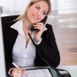 Happy businesswoman talking on telephone — Stock Photo