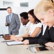 Businesspeople At Presentation — Stock Photo