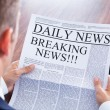 Young Businessman Reading Breaking News — Stock Photo