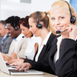 Beautiful Young Woman Talking On Headset — Stock Photo