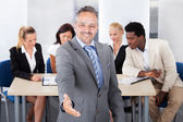 Mature Businessman Offering Handshake — Stock Photo