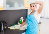 Woman Tired Cleaning Kitchen Worktop At Home — Stock Photo