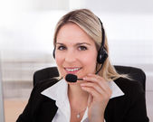 Happy woman Operator With headset — Stock Photo