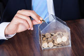 Businessman Inserting Coin In Box — Stock Photo