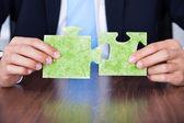 Businessman Holding Eco Friendly Jigsaw Puzzle — Stock Photo