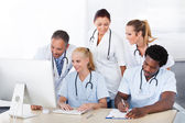 Group Of Doctors Working Together — Stock Photo