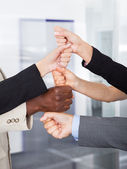 Businesspeople Stacking Fist Over Each Other — Stock Photo