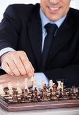 Mature businessman playing chess — Stock Photo