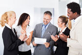 Happy Businesspeople Applauding Businessman — Stock Photo