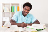 Young African Man Studying — Stockfoto