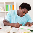 Young African Man Studying — Stock Photo #30728067