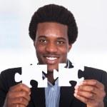 Businessman Holding Jigsaw Puzzle — Stock Photo