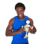 Happy African Athlete Holding Trophy — Stock Photo