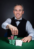 Portrait of a happy croupier — Stok fotoğraf