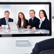 Mature businessman attending video conference — Stock Photo #30908337