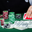 Стоковое фото: Portrait of croupier looking at playing cards