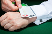 Human hand with playing cards in sleeve — Stock Photo