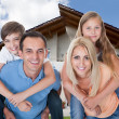 Happy Family In Front Of House — Stock Photo