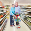 Senior Couple With A Shopping Cart — Stock Photo