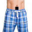 Man with cell phone in shorts — Stockfoto