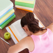 Tired student sleeping on book — Stock Photo
