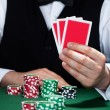 Croupier holding playing cards — Stok fotoğraf