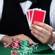 Stock fotografie: Croupier holding playing cards