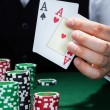 Стоковое фото: Croupier holding playing cards