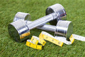 Dumbbells With Measuring Tape — Stock Photo