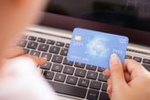 Female Holding Credit Card Over Keyboard — Stock Photo