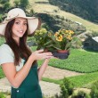 Foto de Stock  : Female Gardener With Flower