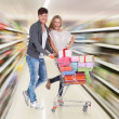 Stock Photo: Couple With Shopping Cart