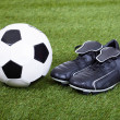 Stock Photo: Football And Cleats On The Field