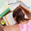 Tired student sleeping on book — Foto Stock