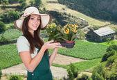 Female Gardener With Flower — Stock Photo