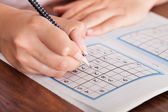 Woman Solving Sudoku — Stock Photo