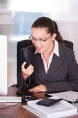 Angry Businesswoman Shouting On Telephone in office — Stock Photo