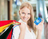 Woman With Bags And Credit Card — Stock Photo
