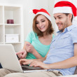 Young couple looking at laptop — Stock Photo #34293417