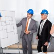Architects Discussing Plan — Stock Photo