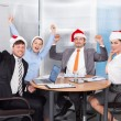 Colleagues In Santa Hat Celebrating — Stock Photo