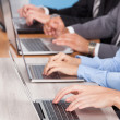 Close-up Of Businesspeople Using Laptop — Stock Photo #34294385