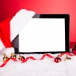 digitale tablet met KERSTMUTS — Stockfoto #34294415