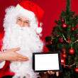 Portrait of a happy santa holding digital tablet — Stock Photo #34294627