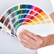 Young man holding color palette — Stock Photo #34294879