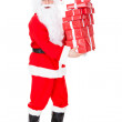Portrait of santa holding stack of gift — ストック写真