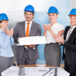 Colleagues Clapping For Man Holding Model — Stock Photo