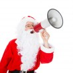 Portrait of santa shouting in megaphone — Stock Photo #34295299