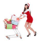 Frau schieben einkaufswagen — Stockfoto