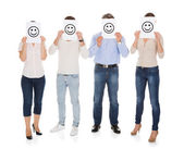Group Of A People Holding Smiley — Stock Photo